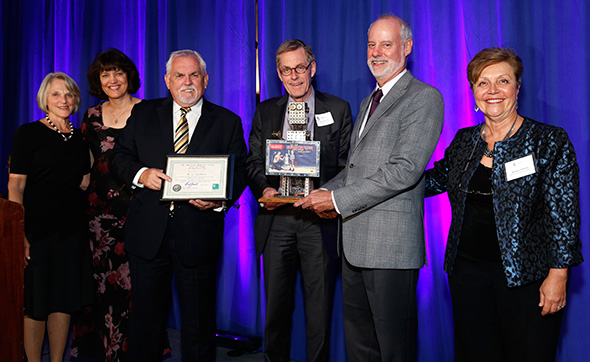 Jeff Marsted and David Gilbert accept award for induction of their grandfather, A.C. Gilbert, into the American Manufacturing Hall of Fame from John Ratzenberger (left) and Barbara Johnson (right)